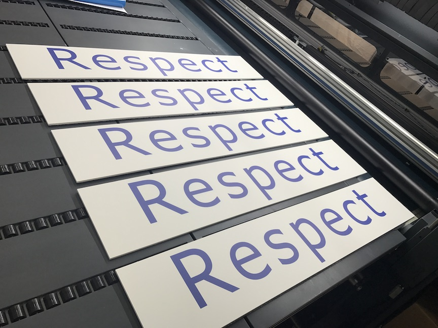 five pvc boards that say respect